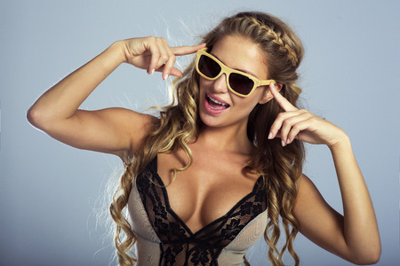 Smiling woman posing in fashionable sunglasses photo