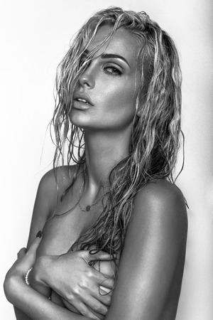 pose sensual: Closeup beauty portrait of blonde sensual woman with perfect makeup and wet hair. Stock Photo
