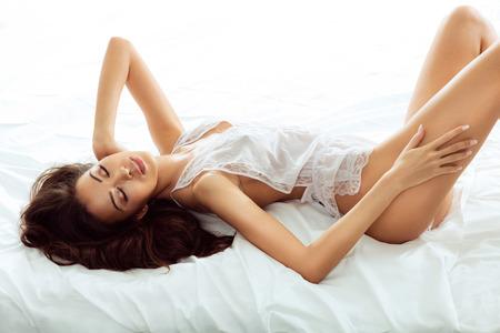 Sexy young brunette girl posing in elegant lingerie,. Perfect fit body. Studio shot. Foto de archivo