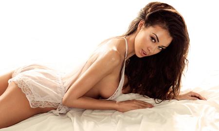 Sensual young brunette beauty posing. Long healthy hair. Girl looking at camera . Stock Photo