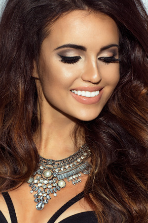 brown eyes: Beauty portrait of attractive young woman with beautiful makeup. Stock Photo