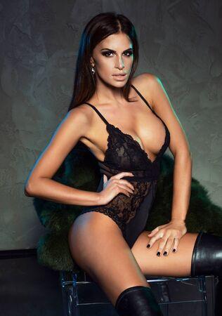 nice breast: Sexy elegant brunette woman posing in black lingerie. Ideal body. Sensual style.