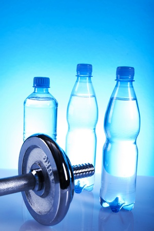 bottles of water and dumbell photo