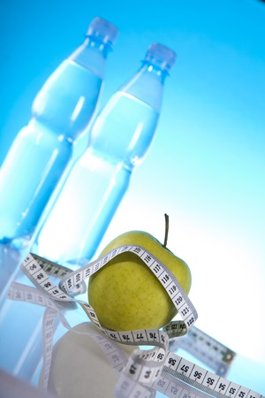 green apple and bottles of water photo