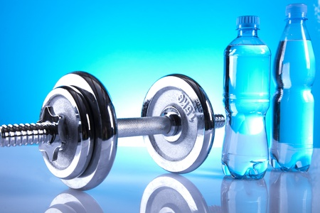 dumbell and bottles of water photo