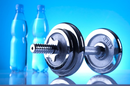 muscle toning: dumbell and mineral water Stock Photo
