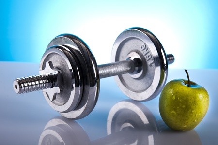 dumbell and green apple
