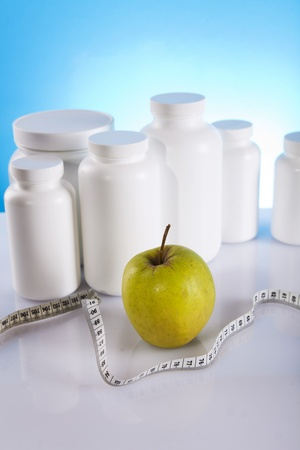 supplements of diet and green apple photo