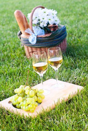 melon field: glasses of white wine and picnic basket