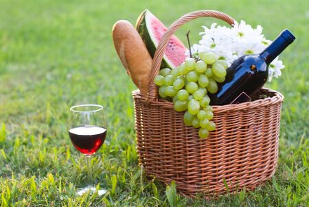 picnic basket with red wine photo