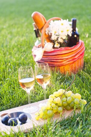 white wine and picnic basket photo
