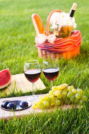 picnic on the grass with red wine photo