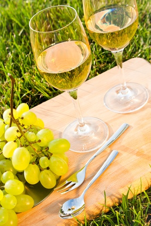 glasses of white wine and grapes photo