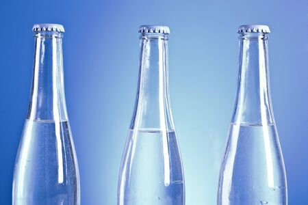 transparent soda bottleas with water drops photo