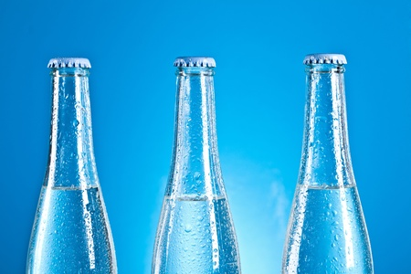 bottles with caps on blue background photo