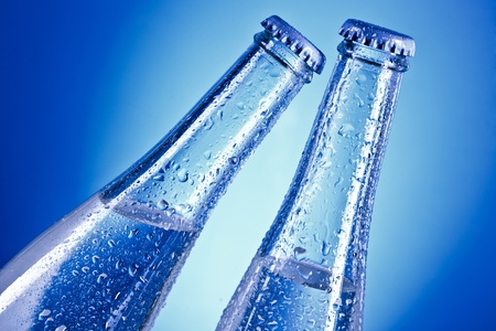 bottles with water drops