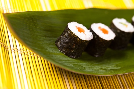 sushi rolls on the leaf photo