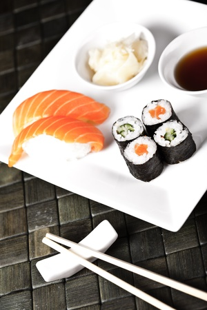 sushi set on the white plate with chopsticks photo