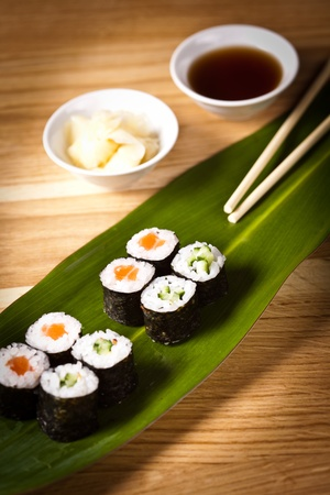 sushi rolls with chopsticks with soy souce photo