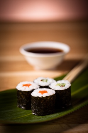sushi rolls with soy souce photo