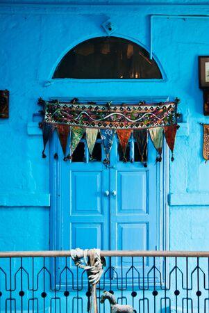 blue door and interior photo