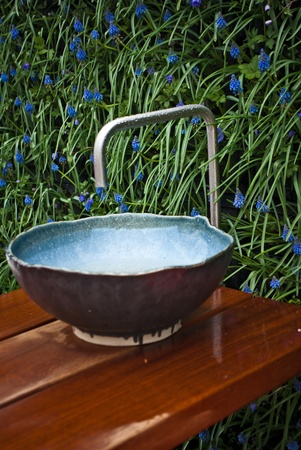 Hand washing basin in the garden, antique and retro style  photo