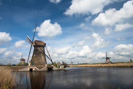 dutch landscape with windmills and blue sky photo