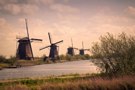 dutch landscape with windmills sepia tone photo