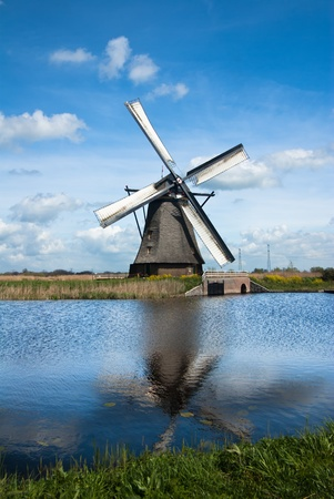 old windmill in dutch countryside photo