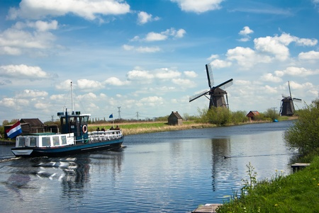 windmills and tourist boat photo