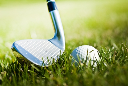 golf ball in grass and shiny club photo