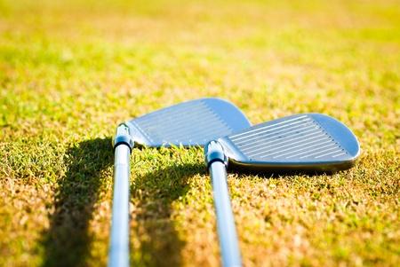 golf clubs on grass