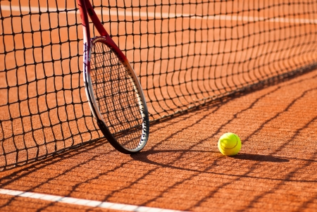tennis racket and ball on court photo