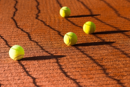 tennis ball on clay court photo