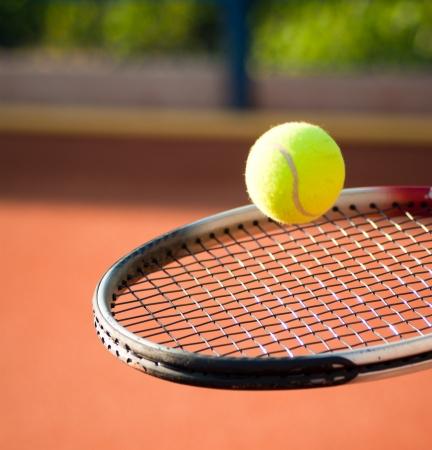 tennis racket: jugar al tenis Foto de archivo