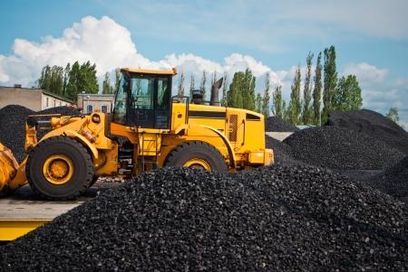 heap of coal and bulldozer