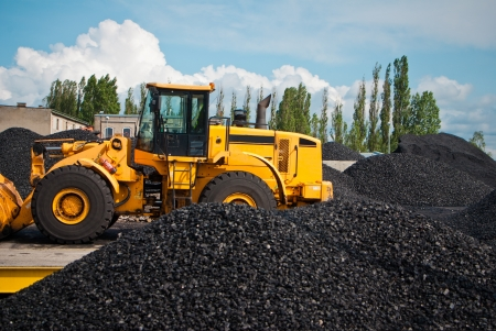 coal truck: heap of coal and bulldozer