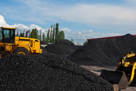 heap of coal and bulldozer photo