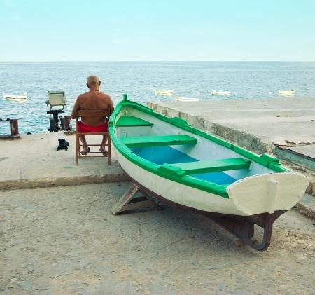 sea side: man relaxing at sea side in Malta