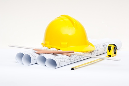 architecture plans: architectural drawings and construction helmet Stock Photo