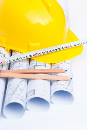 yellow helmet and construction project Stock Photo