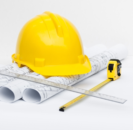 architect tools: yellow construction helmet and architect tools Stock Photo