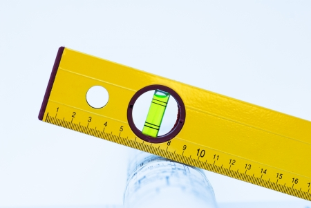 spirit level and rolls of architectural projects Stock Photo - 16547642