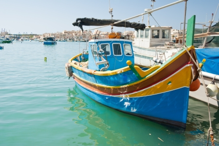 traditional fishing boats in the harbor of Marsaxlokk , Malta Stock Photo - 16547514