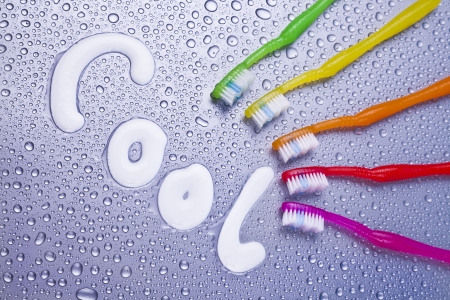 colorful toothbrushes and dental hygiene concept