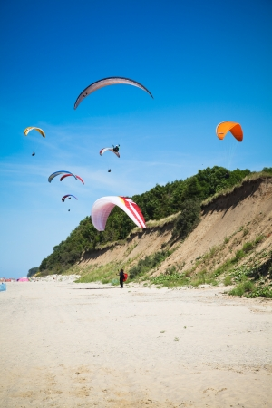 paragliders at the baltic beach Stock Photo