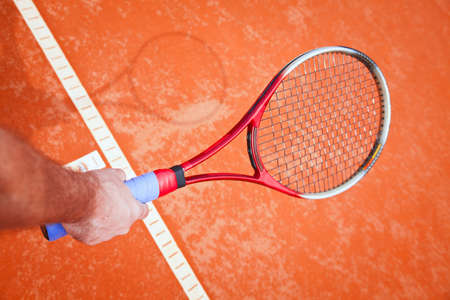 tennis racket in the hand photo