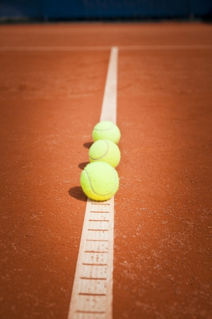 backhand: tennis balls on out line