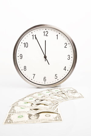 minute hand: Close-up of time and money with white background