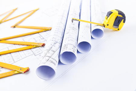 architectural blueprints and construction tools Stock Photo